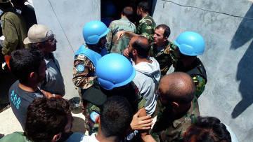 Расследование массового убийства мирных жителей в сирийском городе Хула