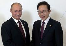 Президент России Владимир Путин и президент РК Ли Мён Бак