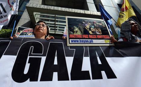 Акция протеста против военных действий в секторе Газа в Маниле