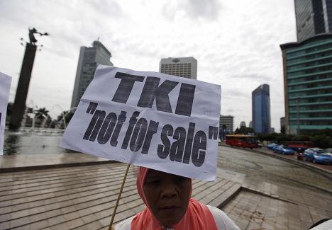 Протест в международный день мигранта в Джакарте