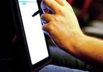 Cоциальная сеть Facebook на планшетном компьютере Apple iPad