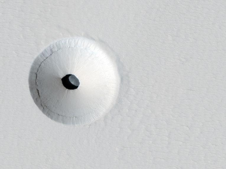 Пещеры и кратеры на Марсе