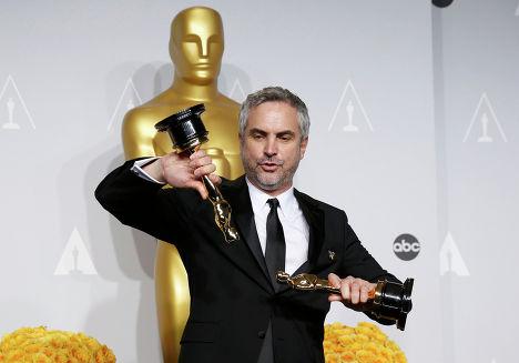 """Мексиканский кинорежиссёр, сценарист и продюсер Альфонсо Куарон на 86-й церемонии вручения премии """"Оскар"""""""