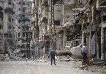 Разрушенные здания на улице Хомса