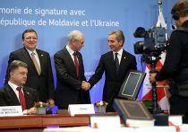 Юрий Лянкэ и Херман Ван Ромпей на саммите в Брюсселе, где Молдавия подписала соглашение с ЕС