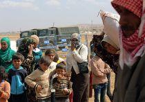 Сирийские беженцы-курды на границе Турции и Сирии