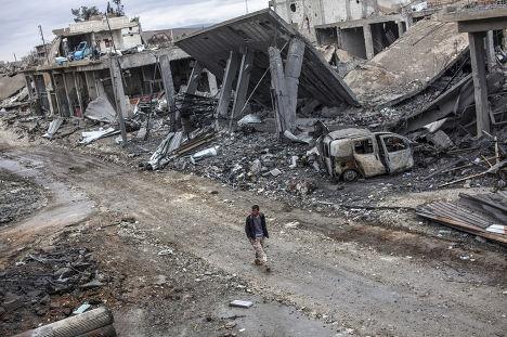 Разрушенные здания в Кобани