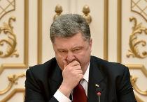 Петр Порошенко зевает во время встречи с лидерами России, Германии и Франции в Минске