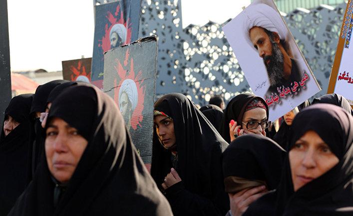 Иранцы на акции протеста против казни шиитского шейха Нимера Бахра Альнимера в Саудовской Аравии