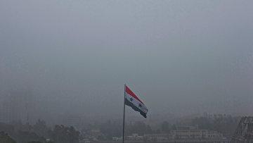 Сирийский флаг развивается над Дамаском