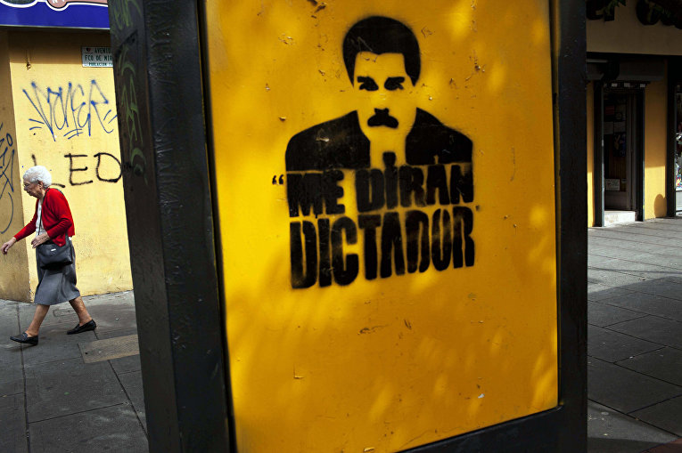 Граффити с изображением портрета президента Венесуэлы Николаса Мадуро