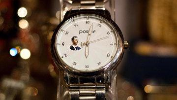 Часы с портретом президента Сирии Башара Асада