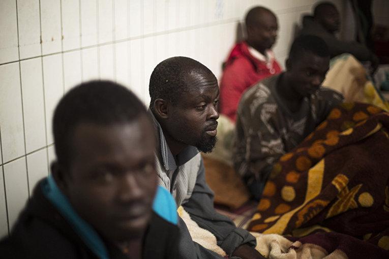 Мигранты из Ганы, Чада и Нигерии в Триполи, Ливия