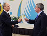 Президент России Владимир Путин и президент МОК Томас Бах