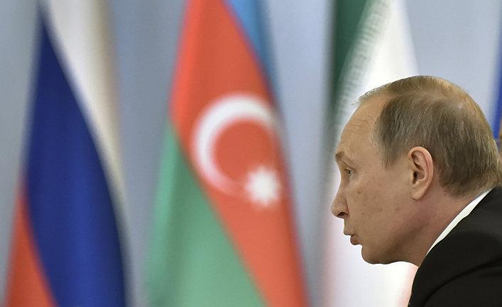 Президент России Владимир Путин на трехсторонней встречи лидеров России, Ирана и Азербайджана