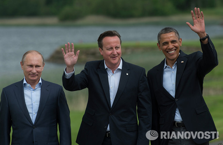 Президент России Владимир Путин, премьер-министр Великобритании Дэвид Кэмерон и президент США Барак Обама