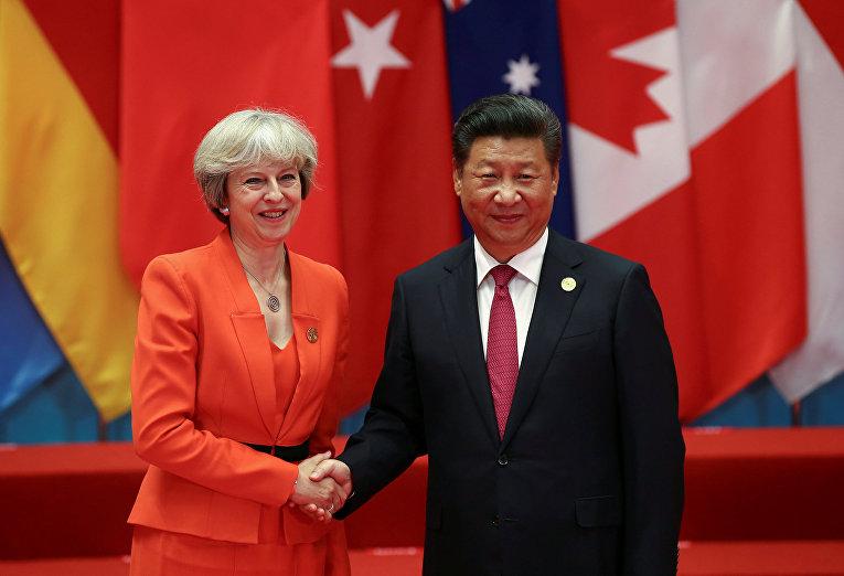 Председатель КНР Си Цзиньпин и премьер-министр Великобритании Тереза Мэй во время саммита G20