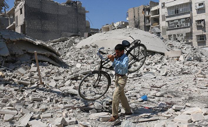 Руины зданий после авиаударов в районе Салихин