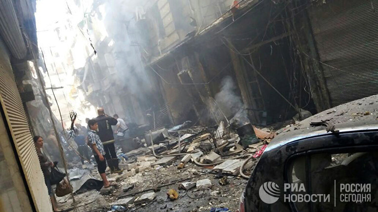 Последствия минометного обстрела христианского квартала Мидан в Алеппо