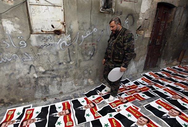Плакаты с изображением Башара аль-Асада в Алеппо