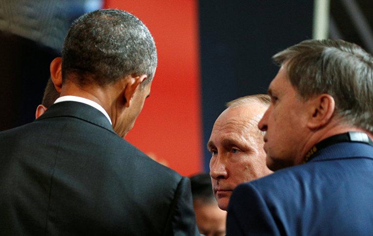Российский президент Владимир Путин и американский лидер Барак Обама на саммите АТЭС в Перу