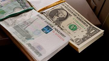 Денежные купюры России и США