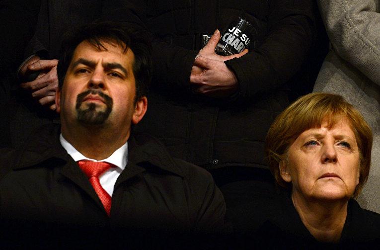 Председатель объединения «Центральный совет мусульман Германии» Айман Мазиек и канцлер ФРГ Ангела Меркель на марше толерантности в Берлине