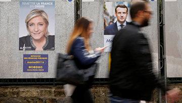 10 апреля 2017. Кандидаты в президенты Франции Марин Ле Пен и Эммануэль Макрон