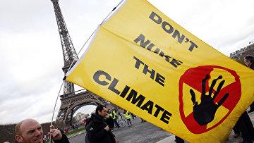 Демонстрация в Париже во время Конференции по климату