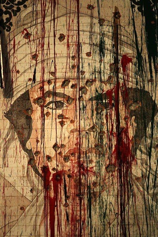портрет Каддафи