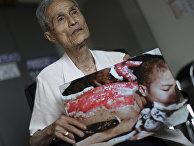 Японец Сумитэру Танигути, выживший после бомбардировки Нагасаки в 1945 году