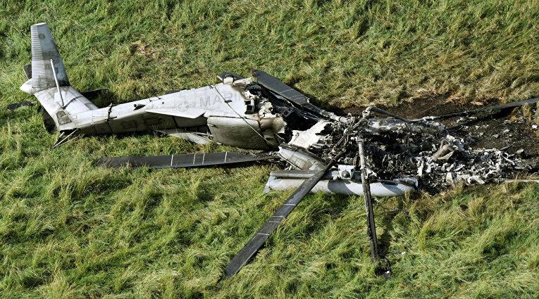 Последствия крушения транспортного вертолета США CH-53E в селе Хигаси на Окинаве в Японии