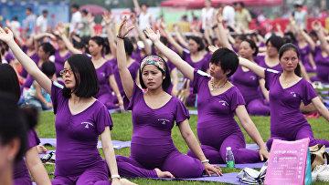 505 беременных женщин приняли участие в занятиях йогой что бы побить мировой рекорд Гиннеса