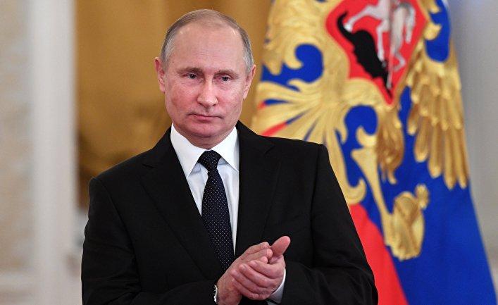 Президент РФ Владимир Путин во время встречи с военнослужащими, принимавшими участие в антитеррористической операции в Сирии. 28 декабря 2017