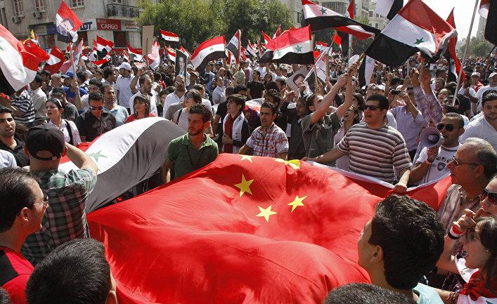 Акция в благодарность Китаю и России за блокирование резолюции Совета Безопасности ООН