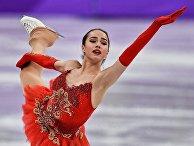 Российская фигуристка Алина Загитова выступает в произвольной программе женского одиночного катания командных соревнований по фигурному катанию на XXIII зимних Олимпийских играх