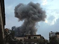 Дым после авиаудара по городу Хаза в Восточной Гуте, Сирия