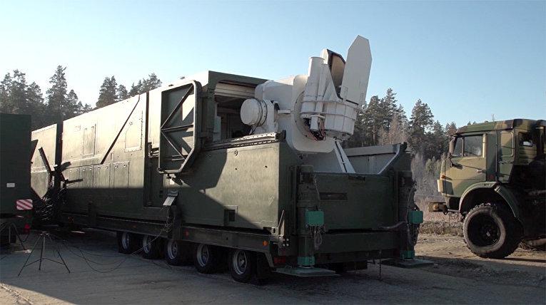Изображение российского лазерного комплекса во время трансляции послания президента РФ Владимира Путина Федеральному собранию комплекс