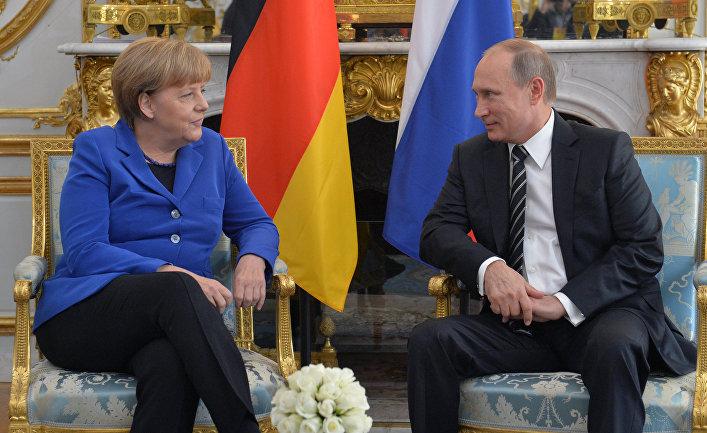 Президент России Владимир Путин и канцлер Федеративной Республики Германия Ангела Меркель во время встречи