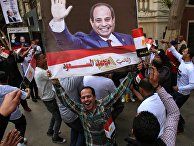 Жители на одной из улиц в Каире во время выборов президента Египта