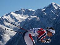 Марит Бьерген (Норвегия) на дистанции индивидуальной гонки в соревнованиях по лыжным гонкам среди женщин на XXII зимних Олимпийских играх в Сочи.