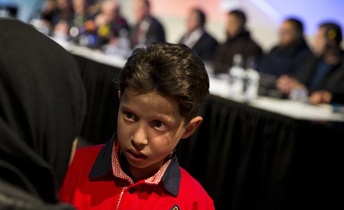 Сирийский мальчик Хасан Диаб на пресс-конференции по вопросу применения химического оружия в Сирии в Гааге. 26 апреля 2018