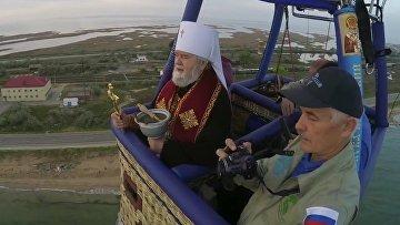 Оккупанты освятили Крымский мост с неба
