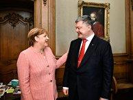 Канцлер Германии Ангела Меркель и президент Украины Петр Порошенко во время встречи в городе Аахен в Германии. 10 мая 2018