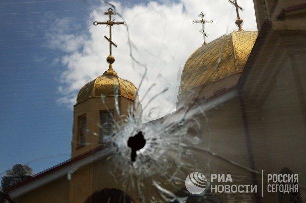 Последствия нападения боевиков на церковь в Грозном