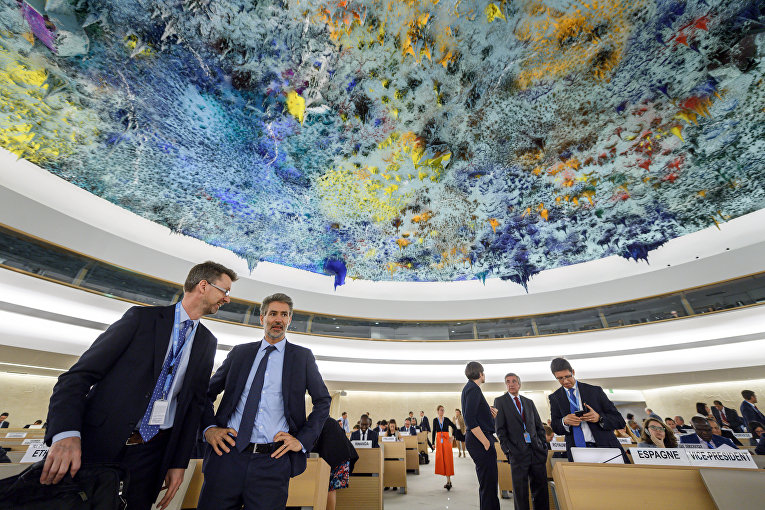 Делегаты перед открытием специальной сессии Совета по правам человека Организации Объединенных Наций в Женеве