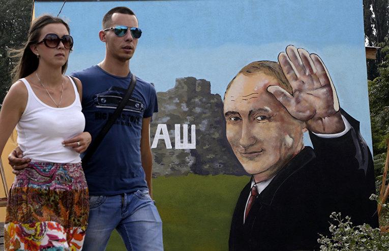 Граффити с изображением президента России Владимира Путина в Симферополе