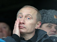 Президент РФ Владимир Путин на подмосковном полигоне Таманской дивизии во время театрализованного представления, посвященного 63-й годовщине разгрома немецко-фашистских войск под Москвой.
