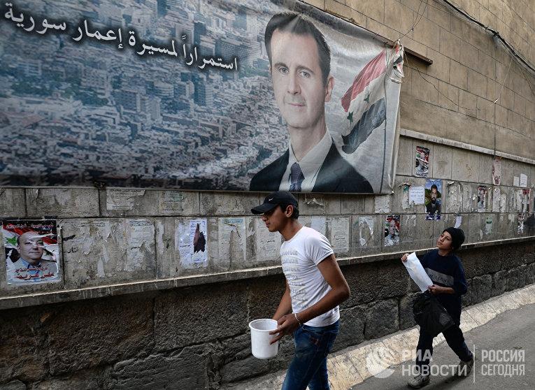 Предвыборные плакаты кандидатов в парламент Сирии