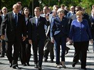Премьер-министр Болгарии Бойко Борисов, президент Франции Эммануэль Макрон, премьер-министр Великобритании Тереза Мэй, канцлер Германии Ангела Меркель перед саммитом ЕС в Софии. 17 мая 2018